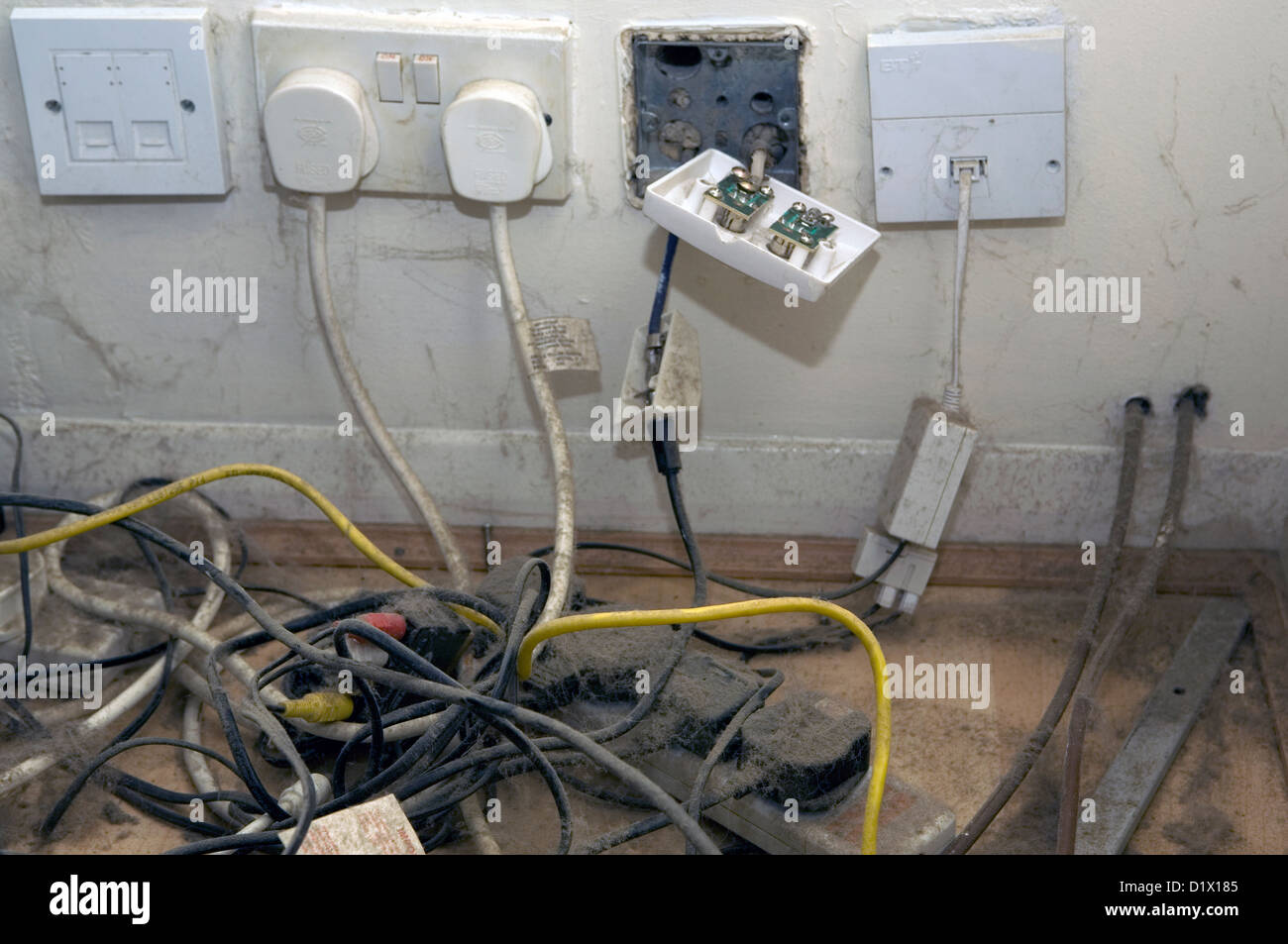 hight resolution of dusty power cables and electrical plugs in a british household