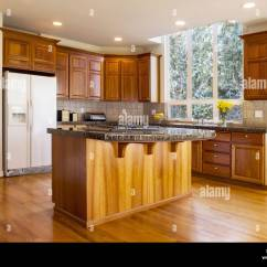 Red Oak Kitchen Cabinets Coloured Small Appliances Stock Photos Modern Daylight With Solid Flooring Cherry Wood Stone Counter To
