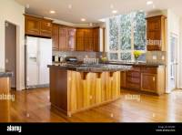 Modern daylight kitchen with solid red oak flooring