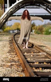Barefoot Woman On Railroad Tracks