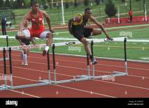 Teens Jump Hurdles In Track And Field Event