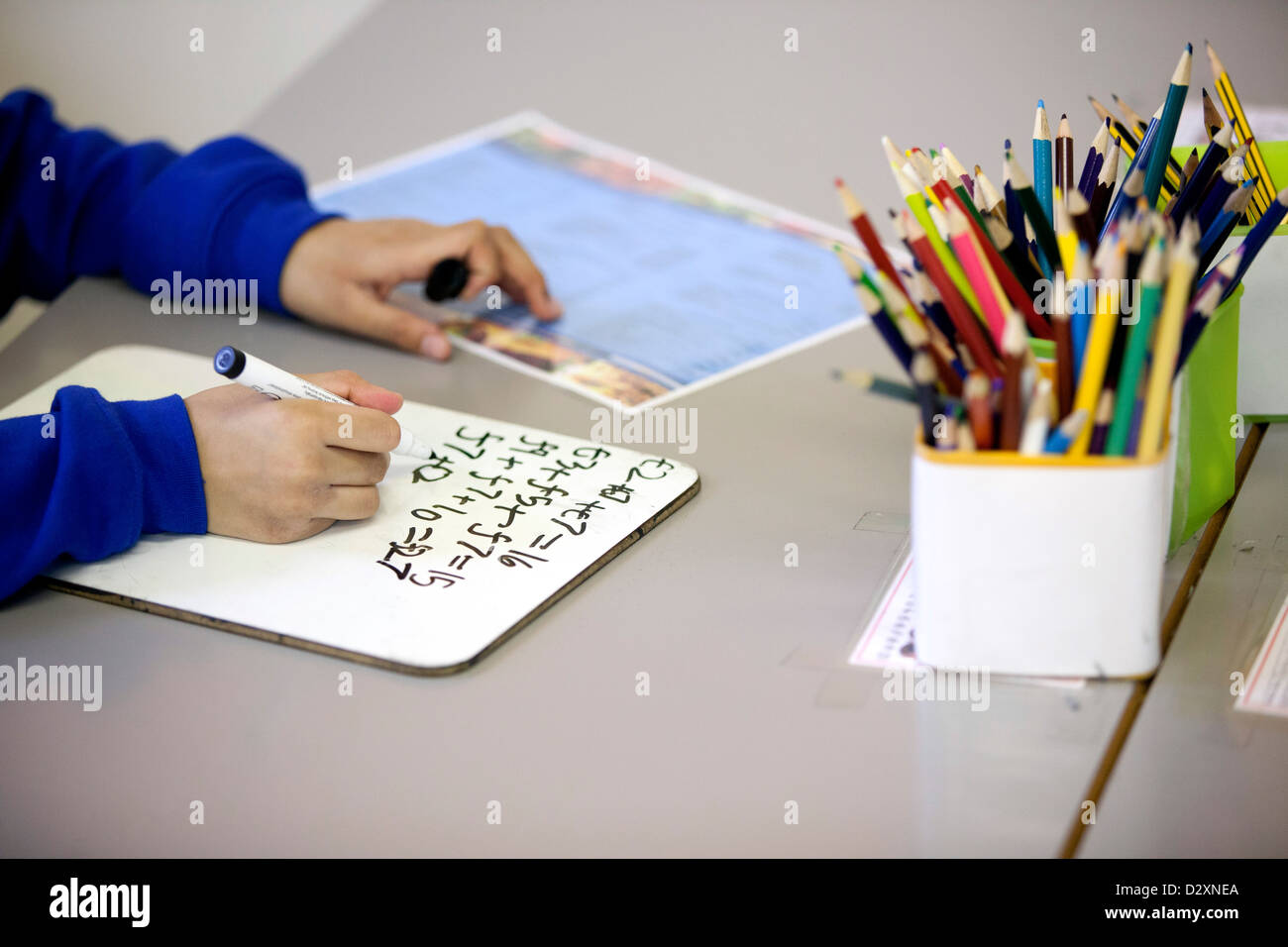 Primary School Child Writing On White Board With Marker