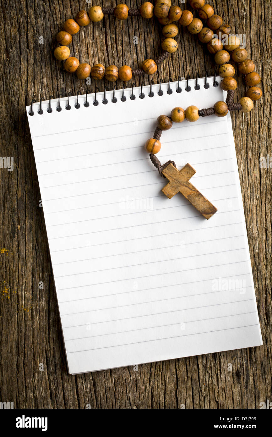 hight resolution of antique rosary beads and blank notebook stock image