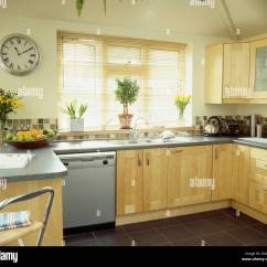 Wooden Kitchen Clock White Cabinets Circular Wall In Modern Pale Wood With Granite Worktops And Built Dishwasher