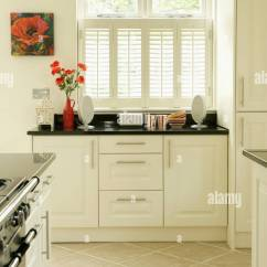 Kitchen Shutters Cabinet Clearance White Plantation On Window In Modern With Black Granite Worktops And Limestone Tiled Floor