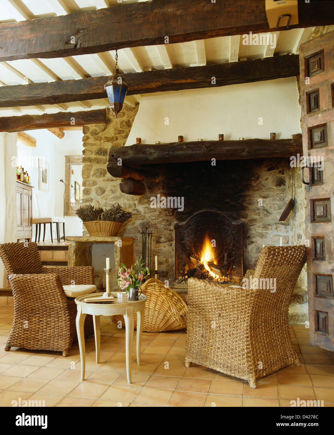 images of small country living rooms linda 3 piece leather room set wicker armchairs and table in french with rustic beamed ceiling fireplace lighted fire