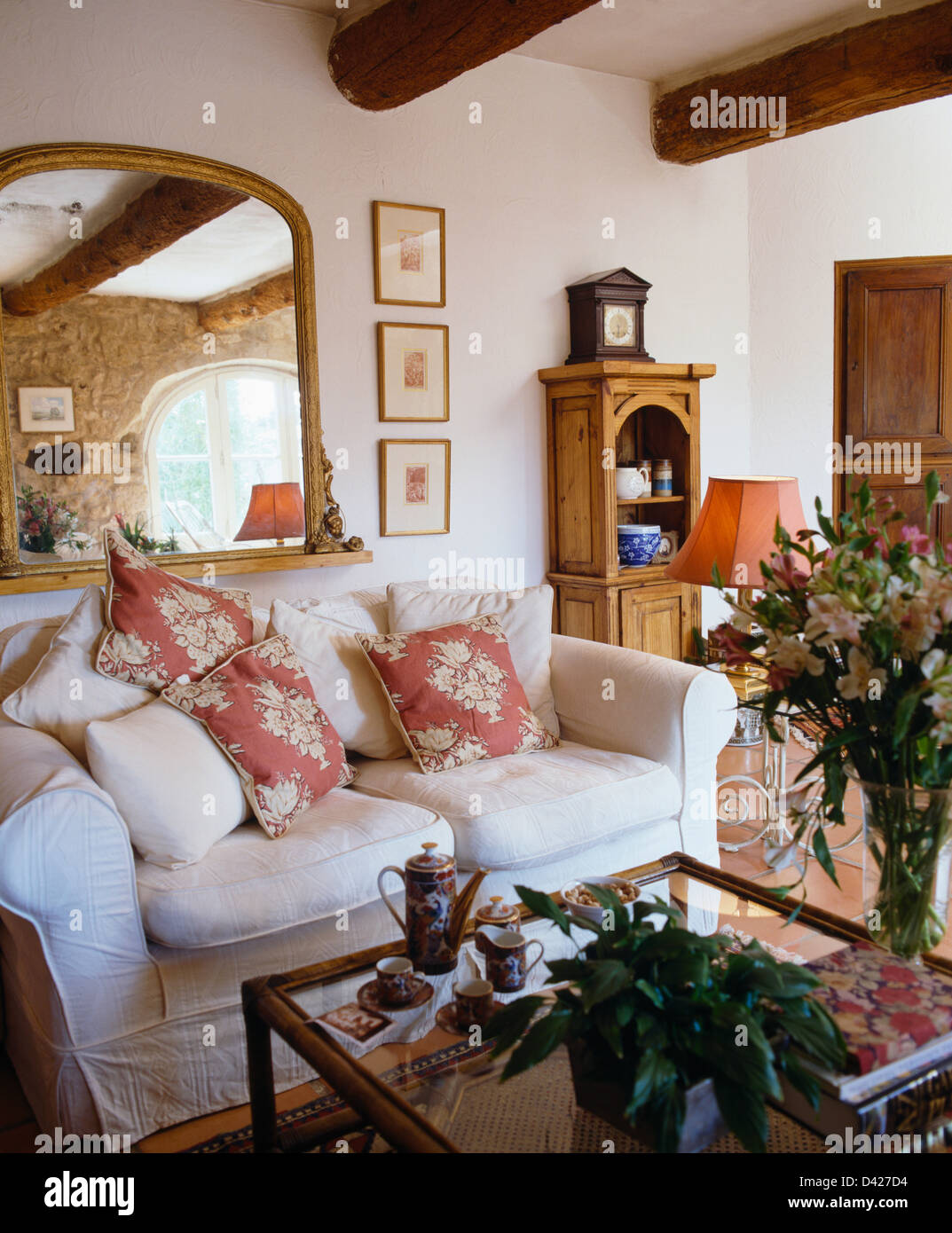 french country living room white and blue ideas large mirror above sofa with pink cushions in