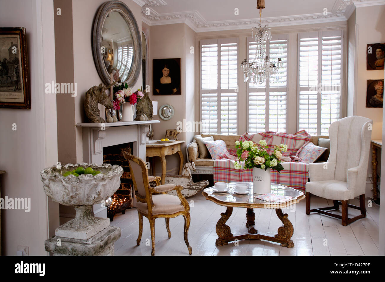 Stone Urn And Painted White Floorboards In Townhouse Living
