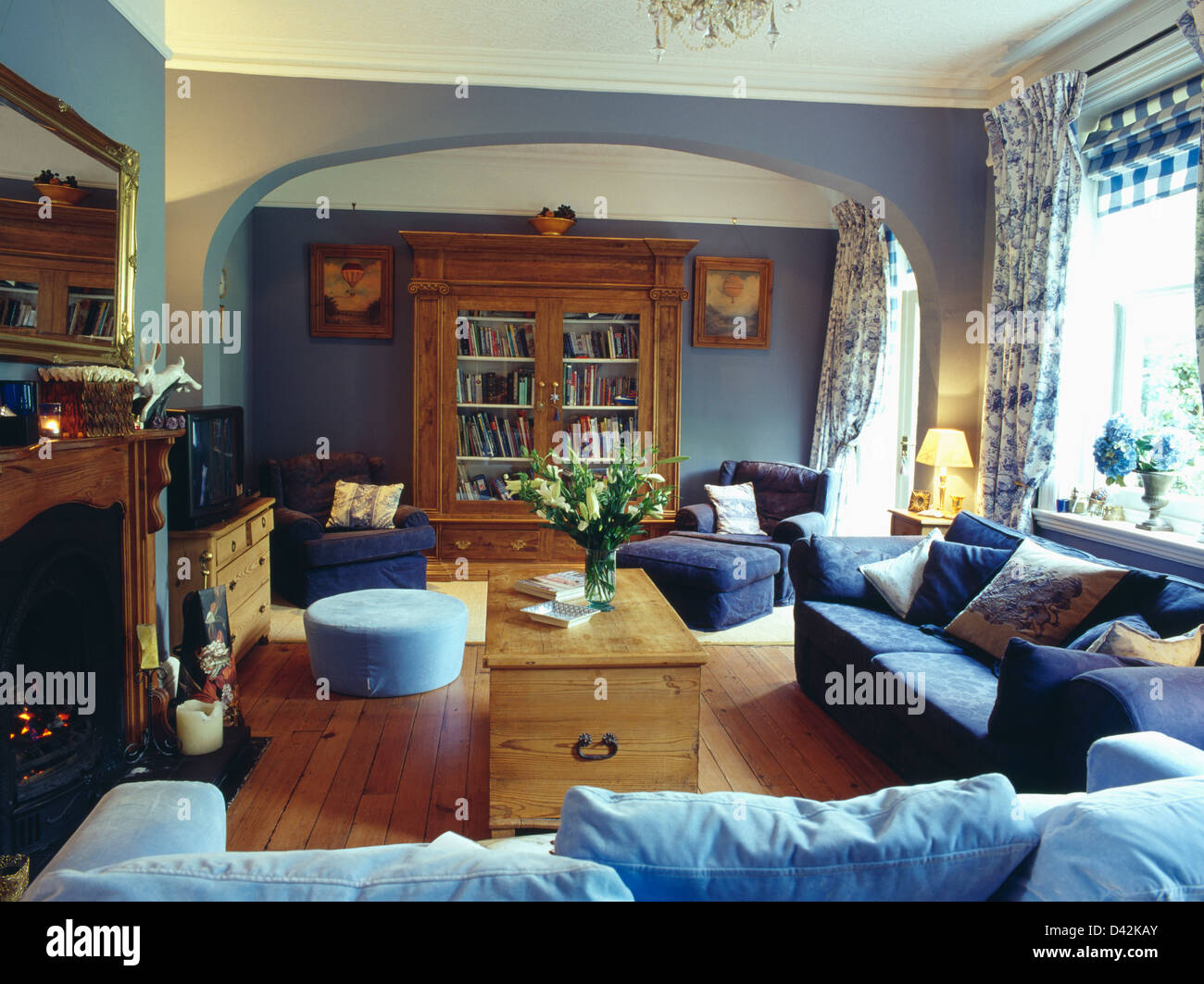 dark blue sofa living room traditional pictures pale and sofas pine chest in with floral curtains wooden floor large cupboard
