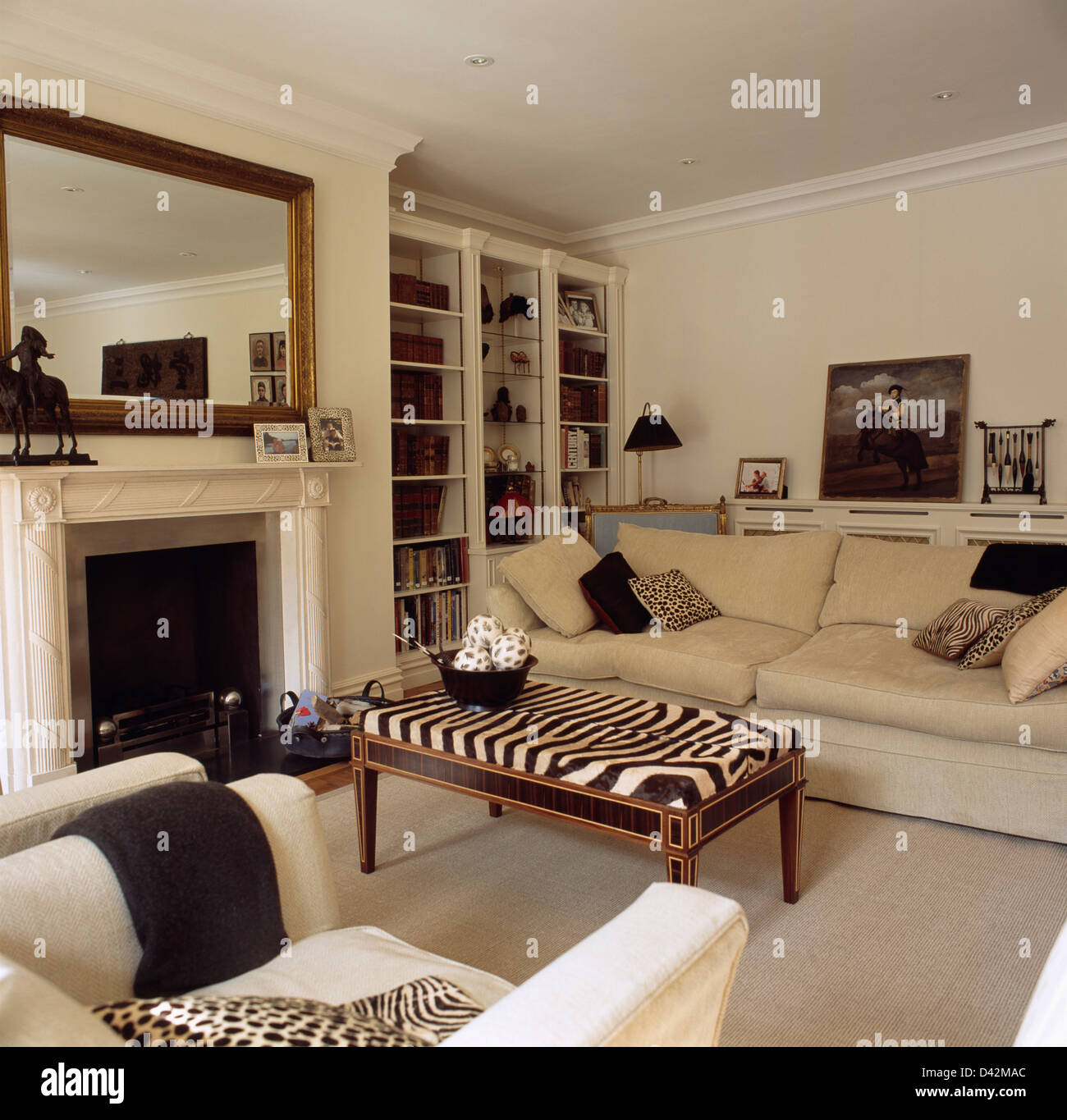 elegant living rooms with fireplaces room furniture arrangement ideas zebra print stool and cream sofa in large mirror above marble fireplace between fitted bookcases