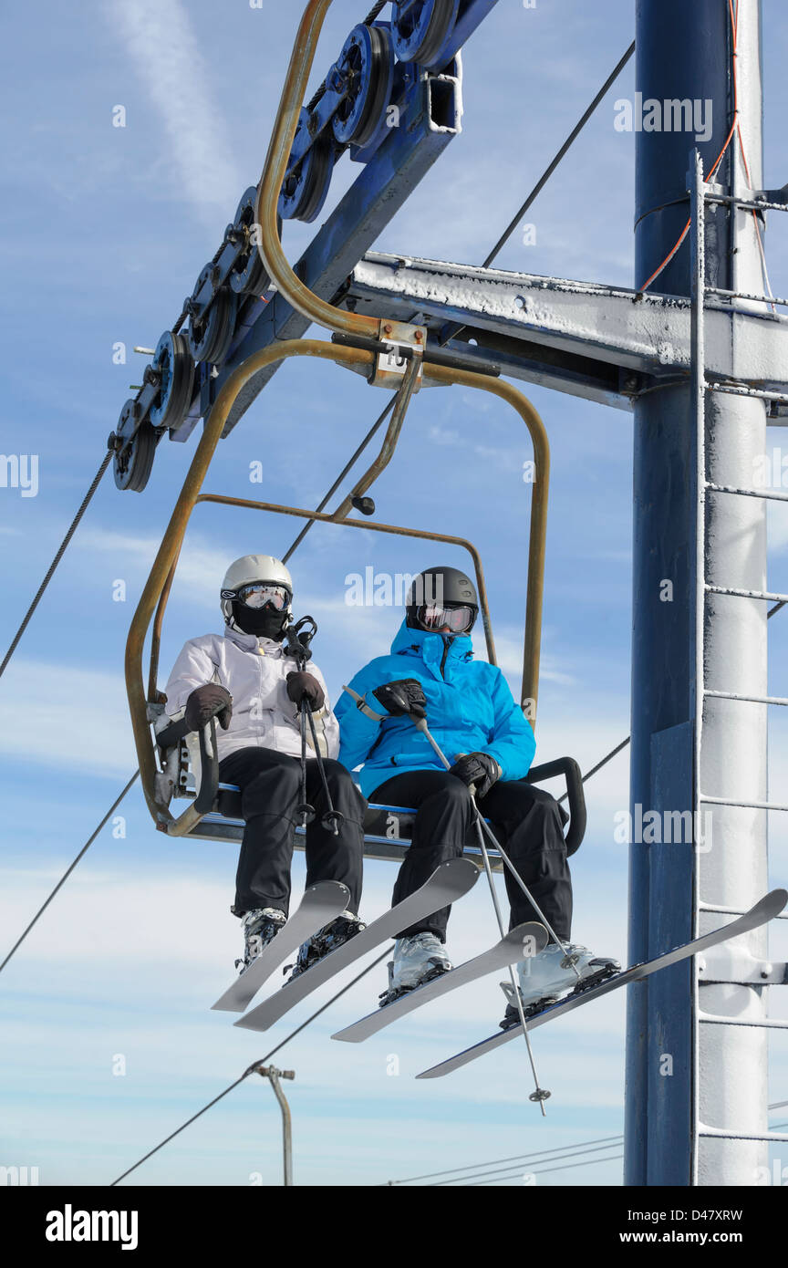 buy ski lift chair fishing tcg two skiers riding in close up man and woman with sunlight fair weather sky background copy space