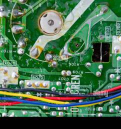 technology background texture of a green metal circuit board with red yellow blue and [ 1300 x 951 Pixel ]