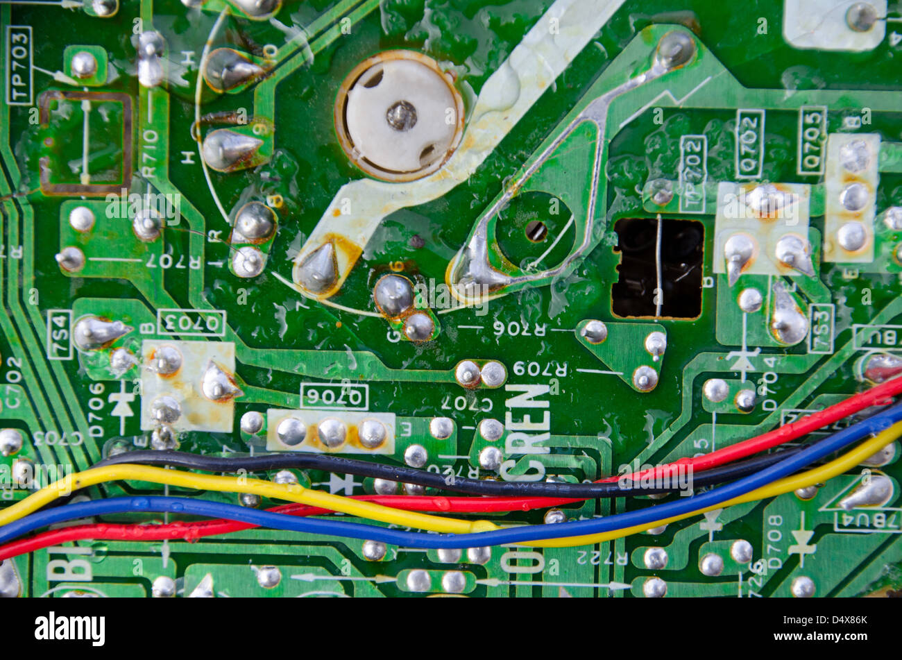 hight resolution of technology background texture of a green metal circuit board with red yellow blue and