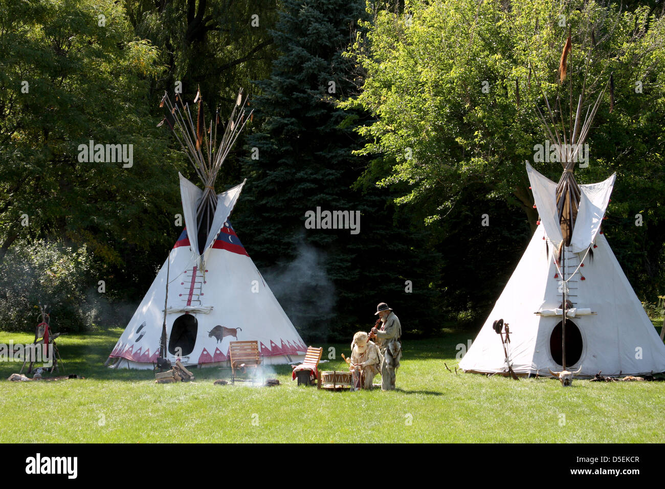 A Native American Indian Tipi Campsite With Men Playing
