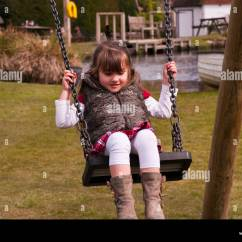 Swing Chair For 5 Year Old Ashley Furniture Rocking Child Swinging On A Stock Photo Royalty