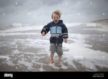 Boy Walking Barefoot Stock &