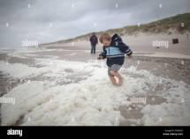 Hvide Sande Denmark Boy Running Barefoot Beach