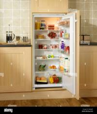 Chilled food in a built in Fridge in oak kitchen units ...