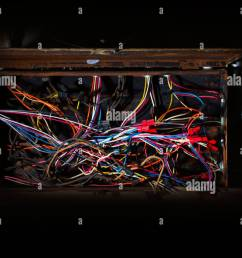old fuse box with mess of wires cables colored coded running in fuse box cables [ 1300 x 956 Pixel ]