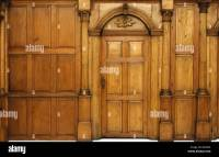 Wooden paneled wall and an arched door Victorian ...