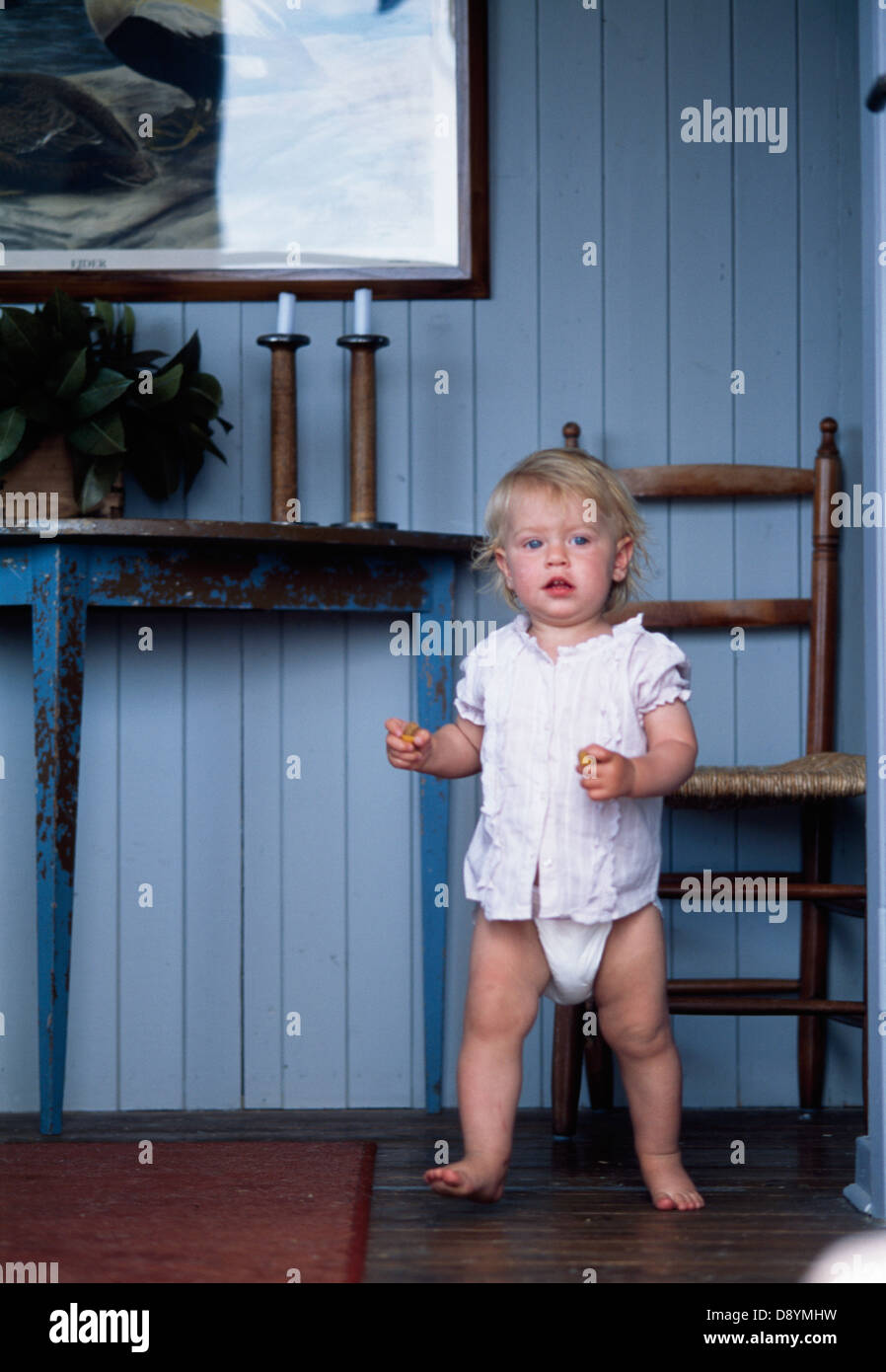 wooden potty training chair canopy with footrest baby girl wearing diaper stock photo: 57157237 - alamy