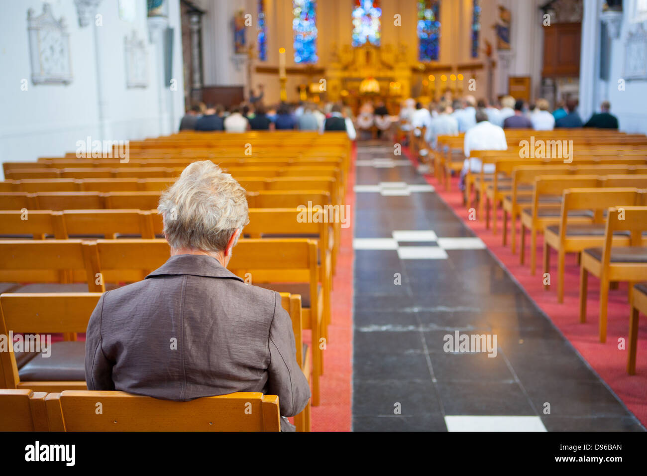 People Sitting And Praying Inside A Christian Church In