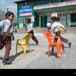Chair Games For Seniors Leg Design Indian Primary Schoolchildren Play A Game Of Musical Chairs In The Village Square At Bharmour Himachal Pradesh India