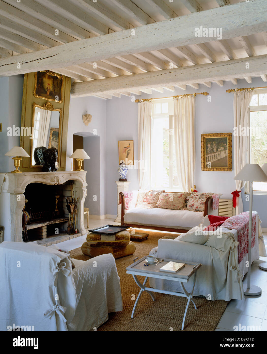 living room covers chair setup white loose on armchair and sofas in french country with painted rustic beams mirror above fireplace