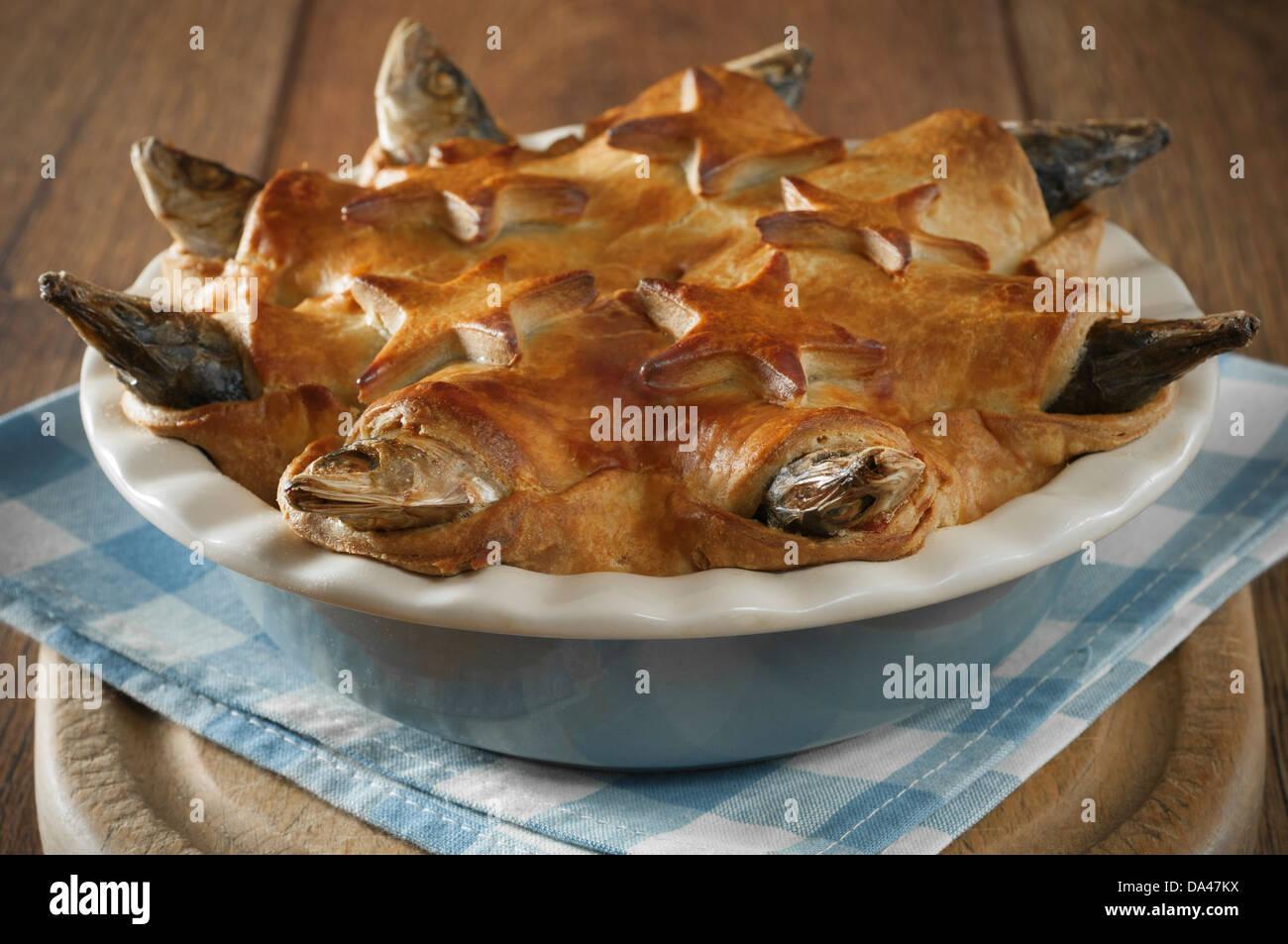 Stargazy pie West Country fish dish Cornwall UK Stock Photo - Alamy