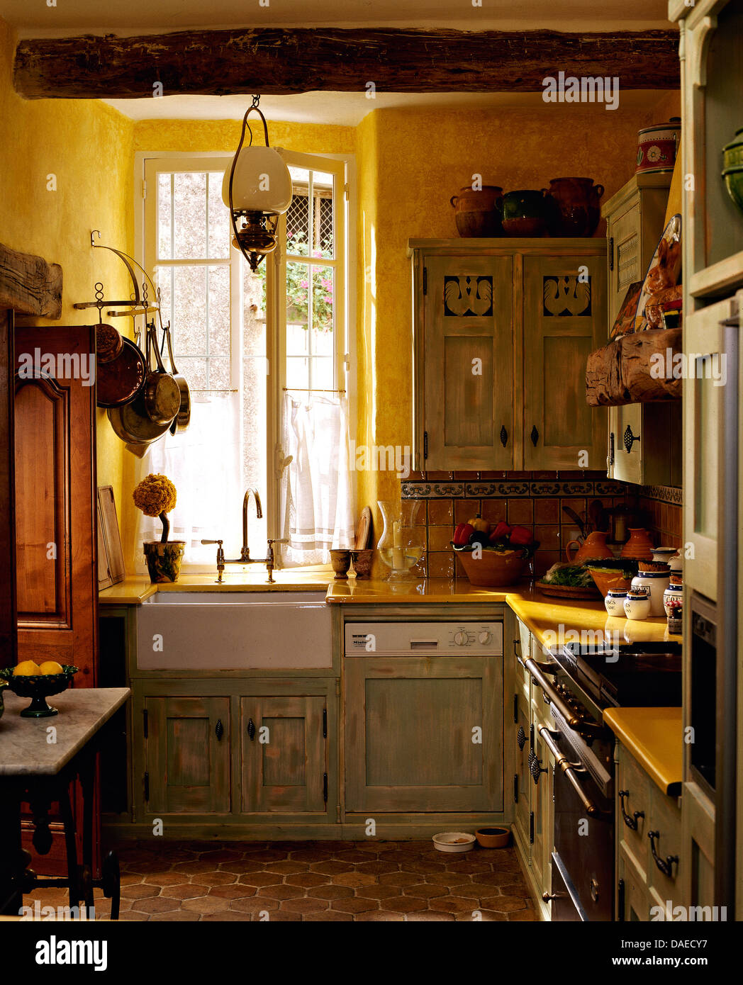 french country kitchens kitchen hood sale pale gray green distressed cupboards in yellow with terracotta tiled floor and belfast sink