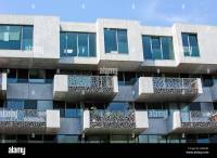 Modern flats with balconies of block of apartments in ...