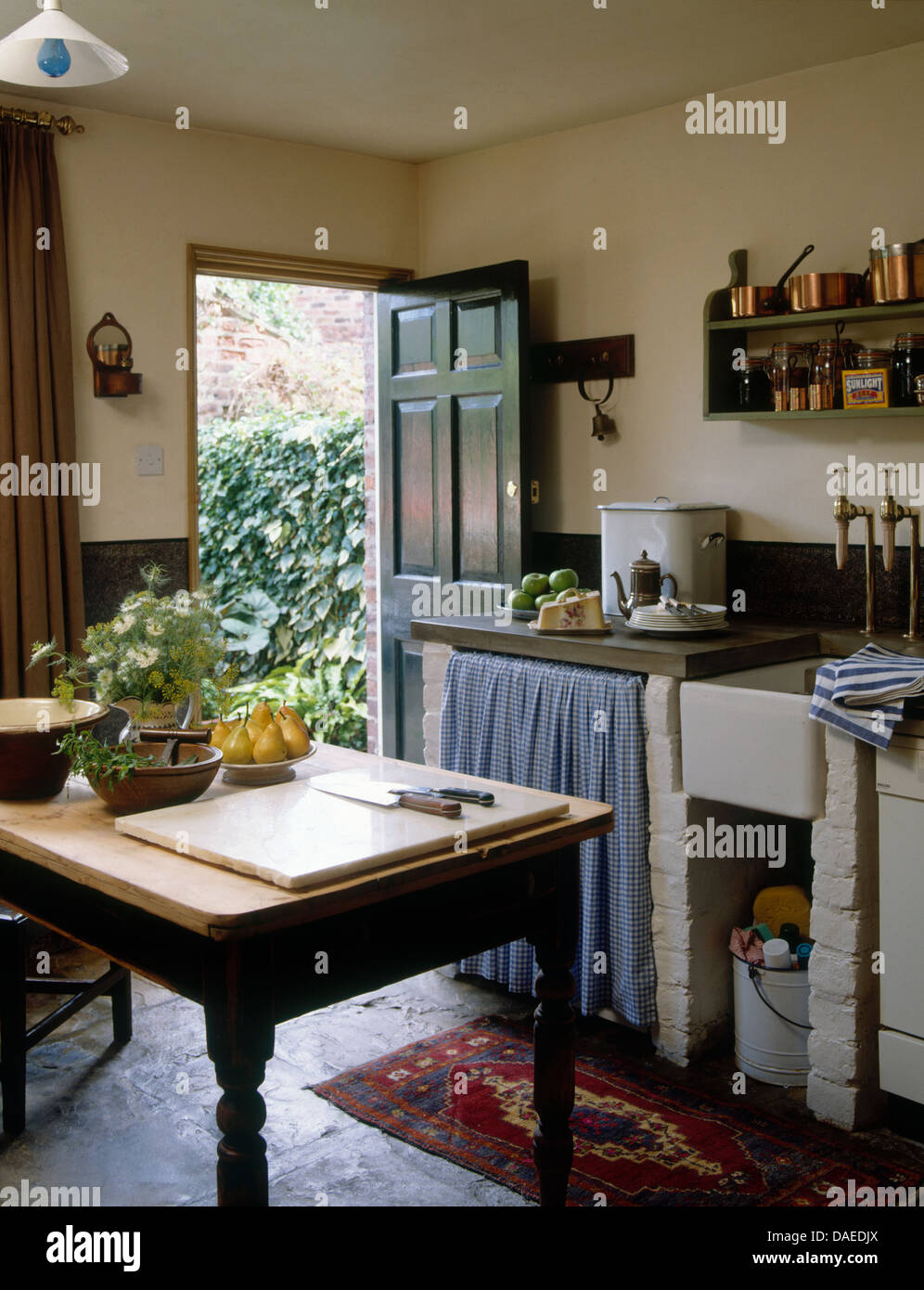 Wooden Table In Center Rustic Country Cottage Kitchen With