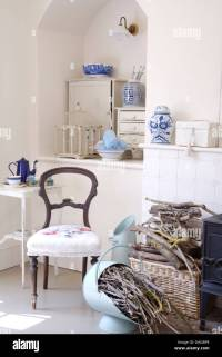 Victorian chair with white seat in front of alcove in ...