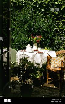 Patio In Country Garden With Wicker Chair Table Set