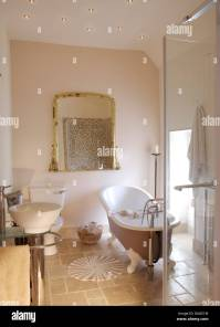Roll top bath and large glass shower cabinet in modern ...