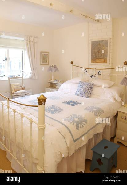 blue and white vintage bedroom Blue cushion and blue+white quilt on vintage brass bed in