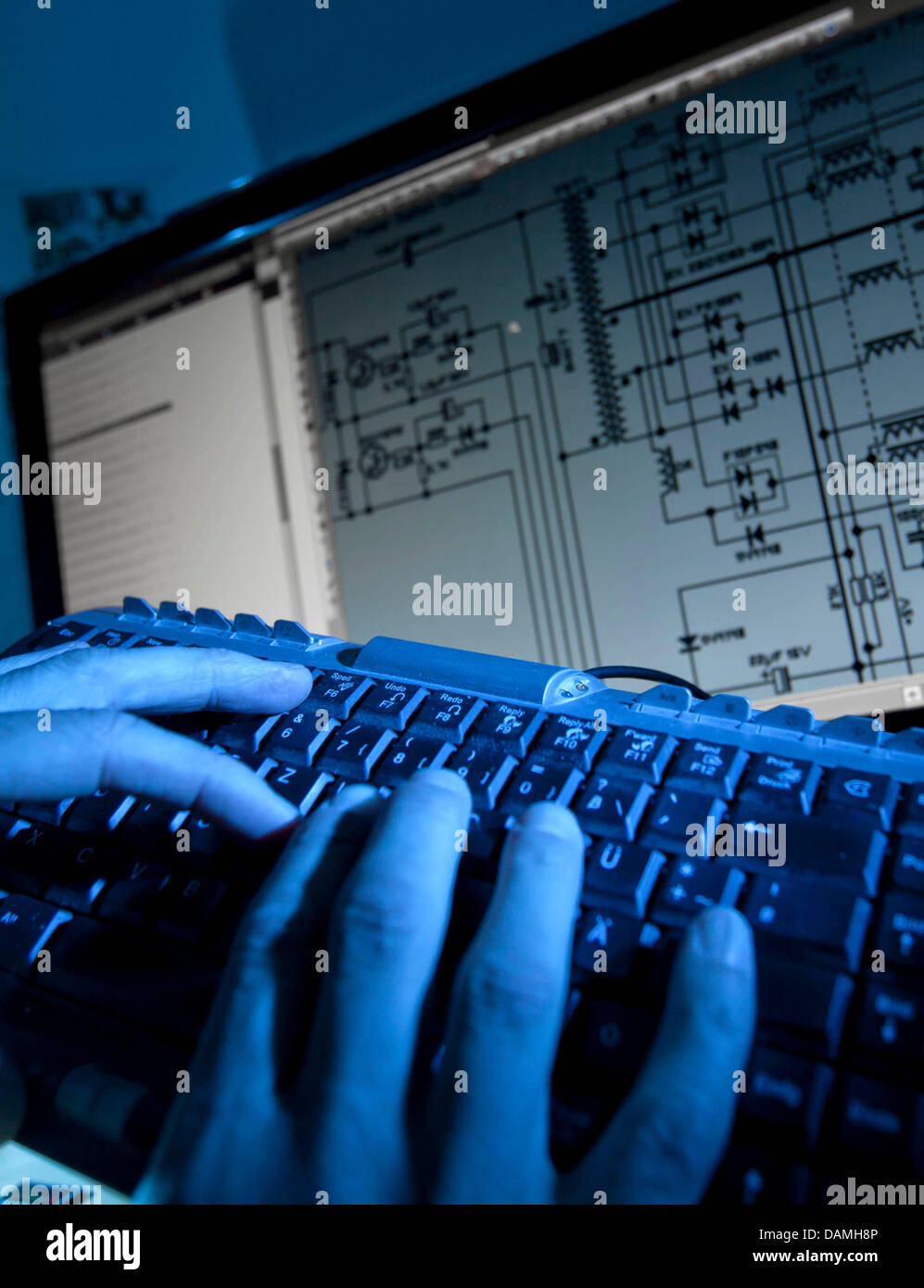medium resolution of a man uses a keyboard next to a circuit diagram in frankfurt am main germany 16 june 2011 german minister of the interior hans peter friedrich opened the