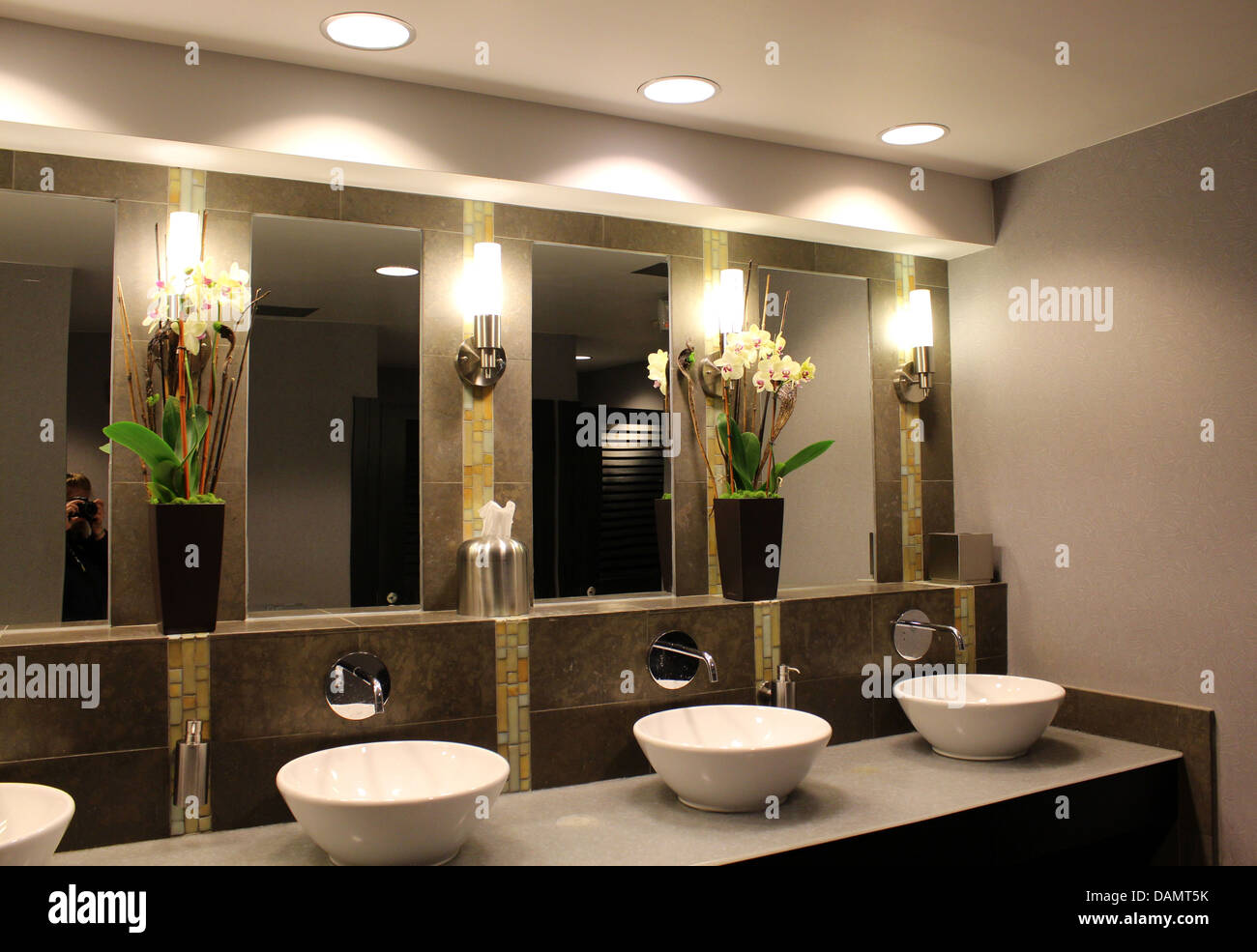 Ultra chic bathroom with fancy sinks,mirrors and flower