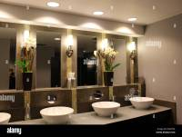 Ultra chic bathroom with fancy sinks,mirrors and flower ...