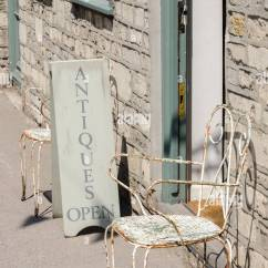 Old Metal Chairs Crushed Velvet Kitchen Chair Covers Sign For Antiques Shop And An On The Pavement In Tetbury