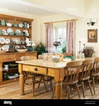 Pine table and chairs and large pine dresser in country
