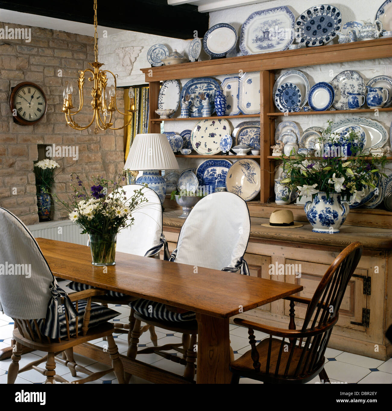 white slip covers for dining room chairs folding chair dimensions simple wood table and with in cottage collection of blue china on old dresser