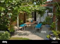 Contemporary garden furniture under wooden pergola and ...