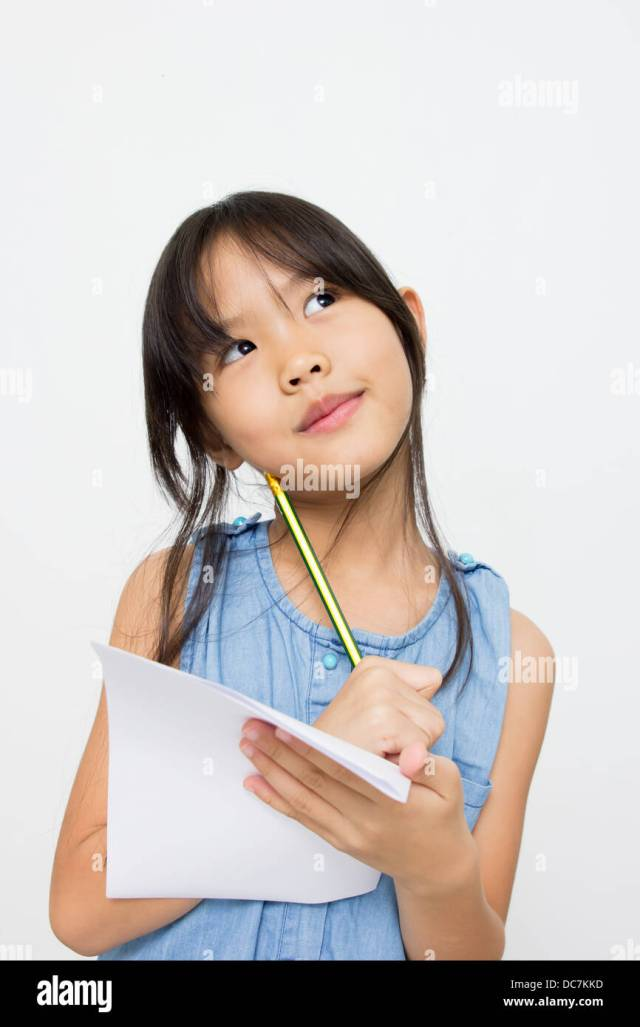 Portrait Of A Cute Little Asian Girl Thinking