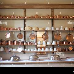 Kitchen Pots And Pans Ikea Freestanding Victorian With Copper Silver Dishes Stock