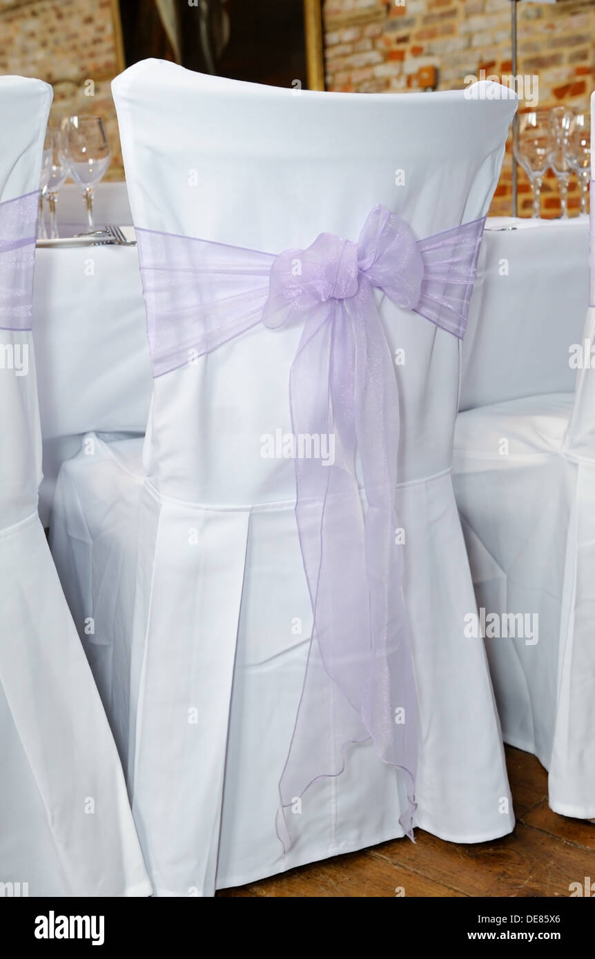 wedding chair covers lilac big bean bag chairs target ribbon in a bow on white cover at reception