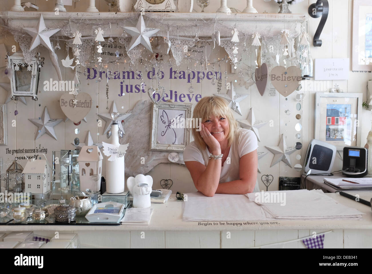Happy Smiling Middle Aged Woman Self Employed Owner Of A Small Stock