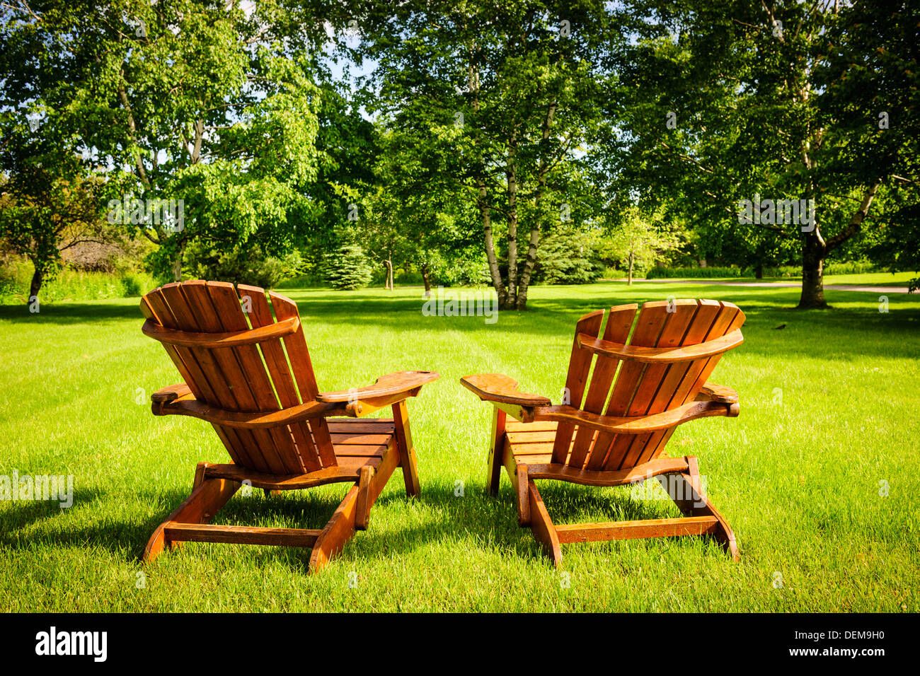 green lawn chairs ladder back dining room adirondack stock photos and