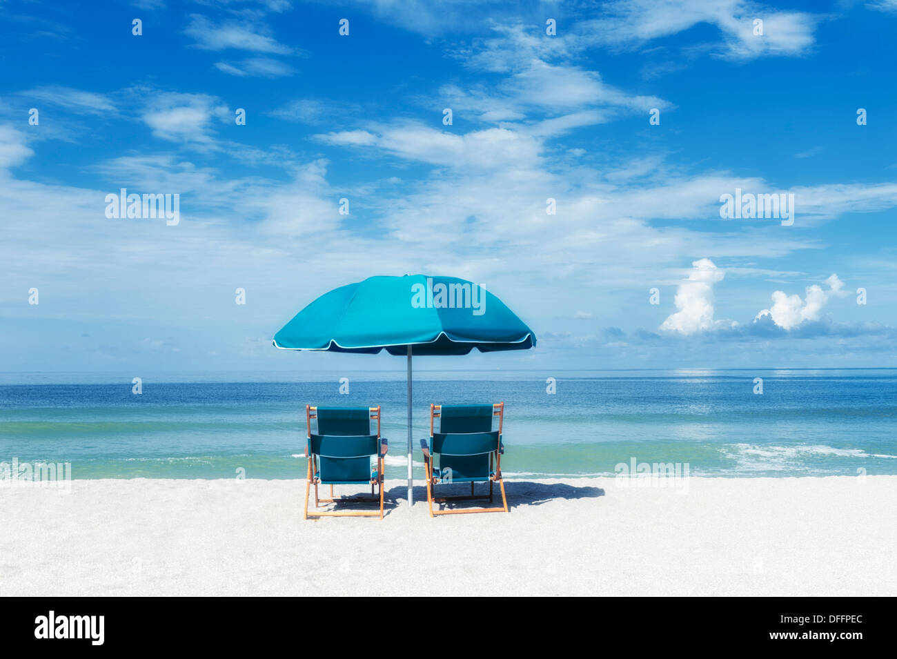 Beach Chairs With Umbrella Two Turquoise Beach Chairs Under Umbrella Facing The Ocean Sea