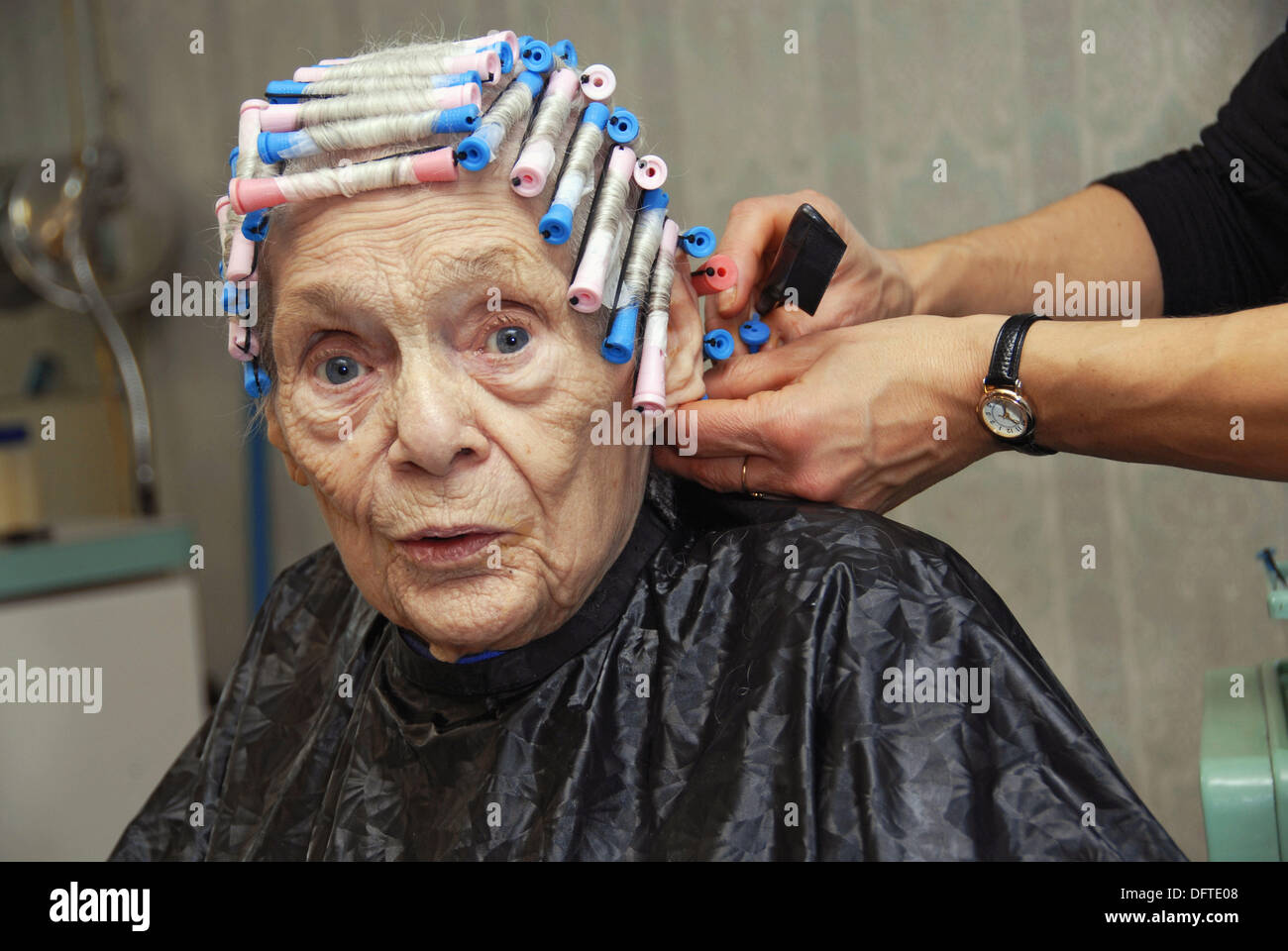 Senior Elderly Woman Has Hair Cut Shampoo Color And Permanent Done By Stock Photo